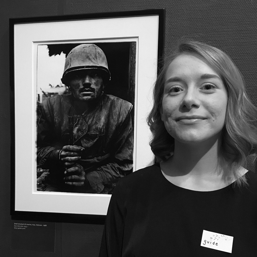 Student, Melanie Hughes next to Don McCullin's image of a shell-shocked US Marine.
