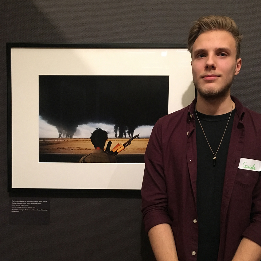 Lazlo Whittaker with Henri Bureau's apocalyptic photograph of a burning oil refinery.